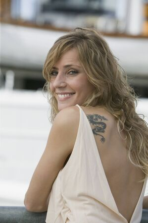 Woman with tattoo looking over shoulder Stock Photo