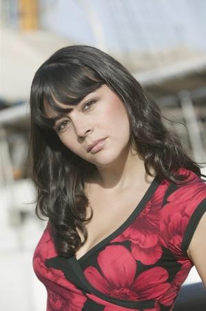 hazel eyes: Portrait of Hispanic woman outdoors