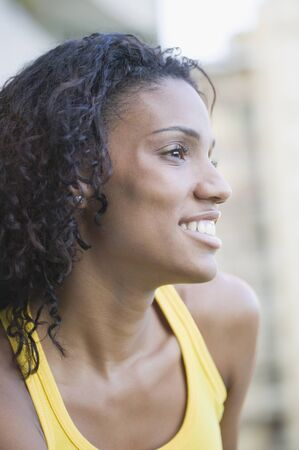 African woman looking to side Stock Photo