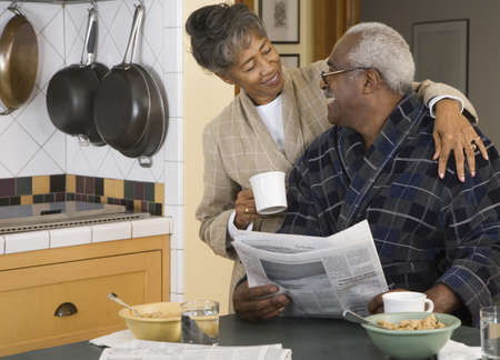 boomers: Senior African couple at breakfast table LANG_EVOIMAGES
