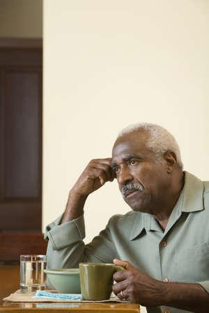 babyboomer: Senior African man at breakfast table