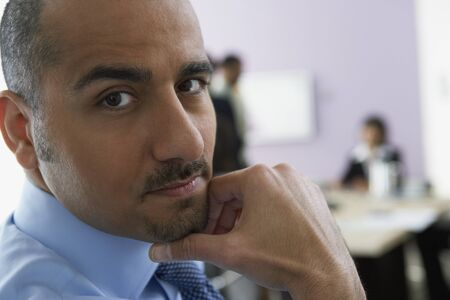 daydreamer: Close up of Middle Eastern businessman