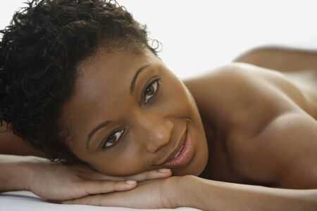 mischeif: African woman laying on spa table