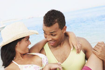 gratifying: Couple hugging at beach LANG_EVOIMAGES