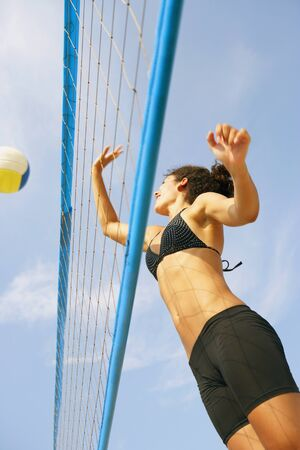 submerging: Young woman playing volleyball