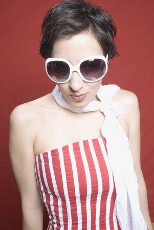 unconcerned: Hispanic woman wearing sunglasses