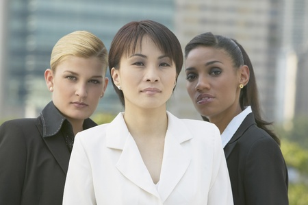 Three multi-ethnic businesswomen outdoors