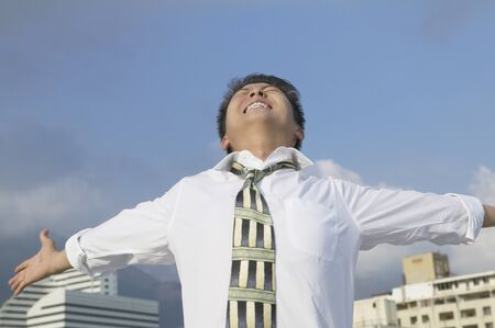 Asian businessman with arms outstretched