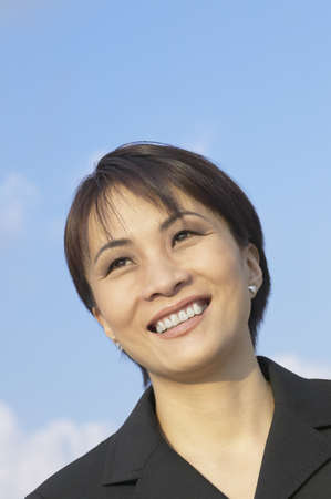 scrunched: Close up of Asian businesswoman smiling