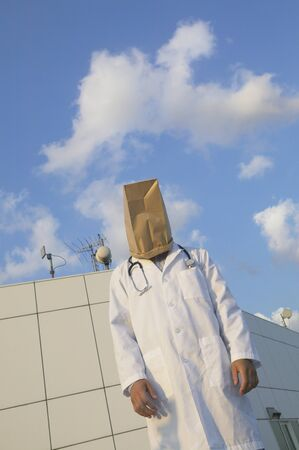 seriousness skill: Male doctor wearing bag over head