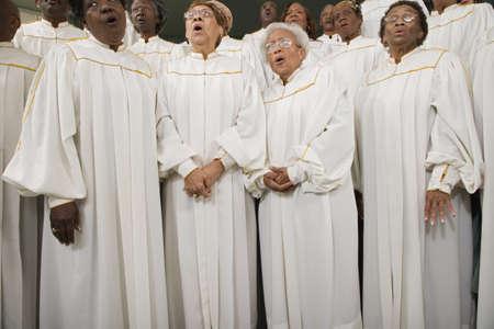 low spirited: African seniors singing in choir