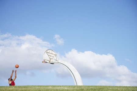 African man shooting basketball Stock Photo