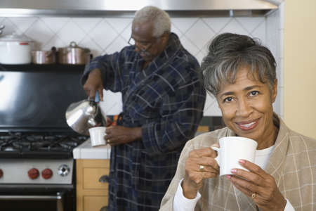 Senior African couple drinking coffee