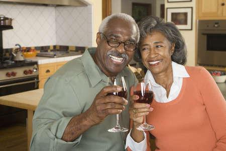 babyboomer: Senior African couple toasting with wine