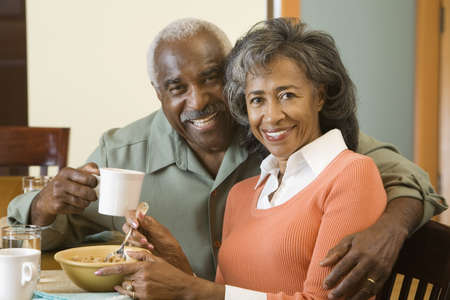 Senior African couple at breakfast table Stock Photo