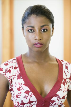 v neck: African woman wearing v neck blouse