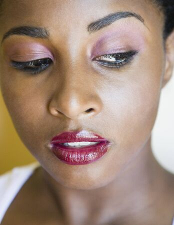 relishing: Close up of African woman looking down LANG_EVOIMAGES