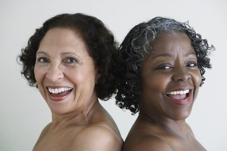 Two senior African women with bare shoulders Stock Photo