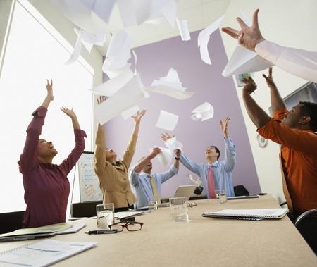 german ethnicity: Businesspeople cheering at meeting