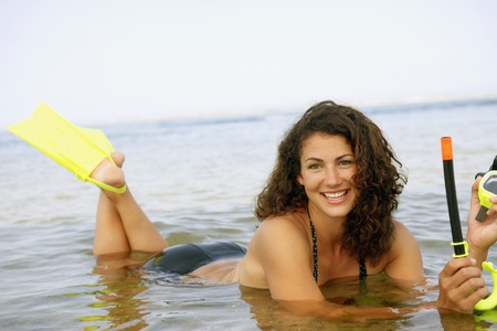 mate married: Woman with snorkel gear in water