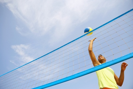 low spirited: Hispanic man playing volleyball
