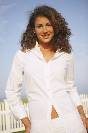 Young woman wearing button down shirt