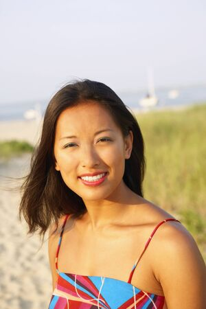 low blouse: Asian woman at beach LANG_EVOIMAGES