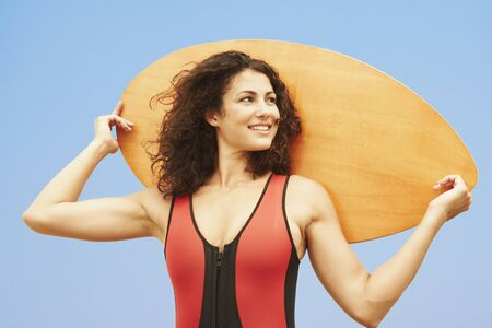 boogie: Young woman holding boogie board LANG_EVOIMAGES