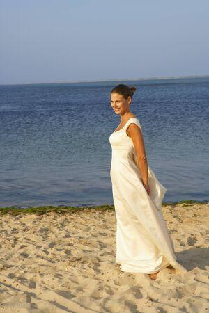 milepost: Bride walking on beach LANG_EVOIMAGES