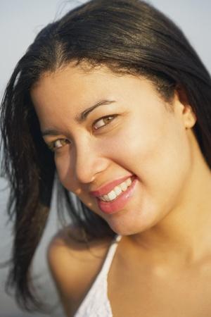 dangling: Close up of Hispanic woman smiling