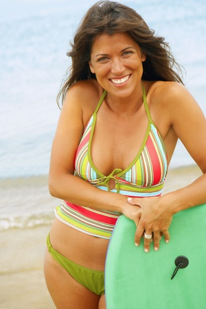 boogie: Young woman leaning on boogie board