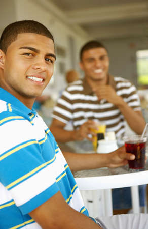 Hispanic men drinking at bar Imagens