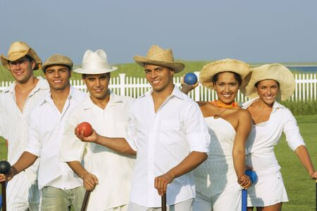 longshot: Multi-ethnic friends playing croquet