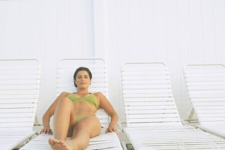 fathering: Young woman sunbathing