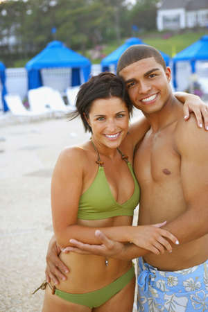 bathingsuit: Young couple hugging at beach LANG_EVOIMAGES