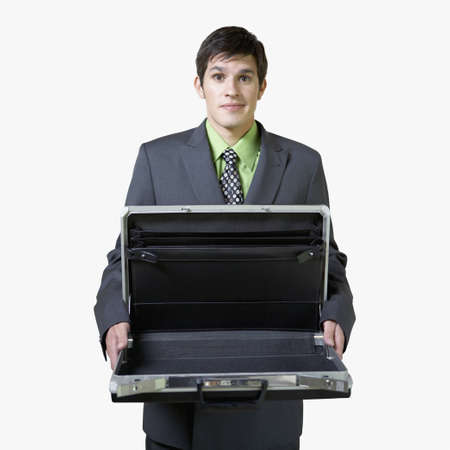 jazz time: Hispanic businessman holding empty briefcase LANG_EVOIMAGES
