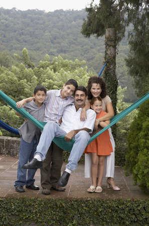 wearying: Hispanic family hugging outdoors