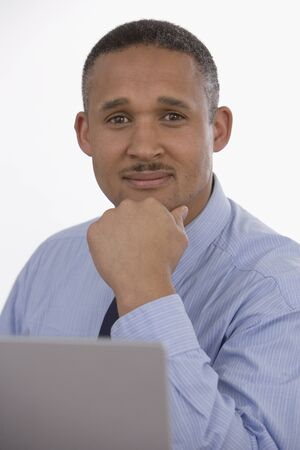 talker: African businessman resting chin on hand