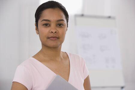 talker: Indian businesswoman holding notebook LANG_EVOIMAGES