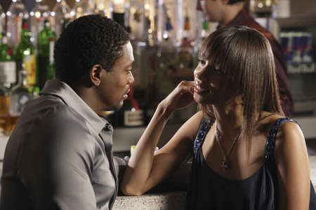 barkeep: African couple talking at bar
