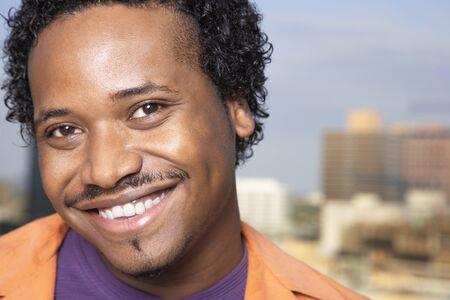 relishing: Close up of African man smiling