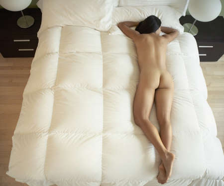 20's nude: Nude Asian woman laying on bed
