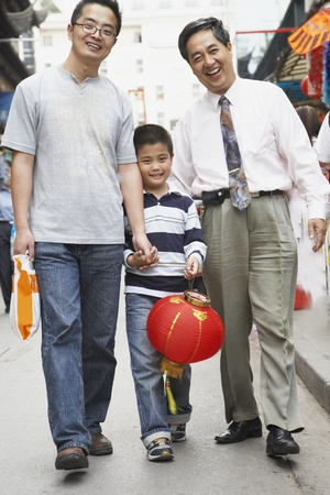 italian ethnicity: Asian grandfather, father and son walking on sidewalk