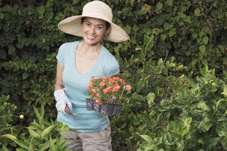 unconcerned: Hispanic woman gardening
