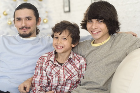 davenport: Hispanic brothers sitting on sofa