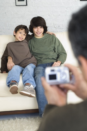 Hispanic brothers having photograph taken