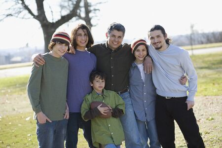 playing on divan: Portrait of Hispanic family at park