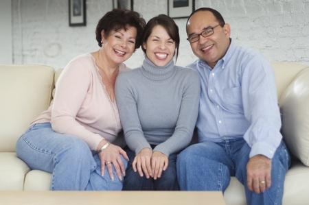 grampa: Hispanic parents and adult daughter on sofa