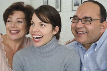 Portrait of Hispanic parents and adult daughter