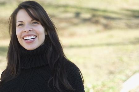 gramma: Hispanic woman laughing outdoors
